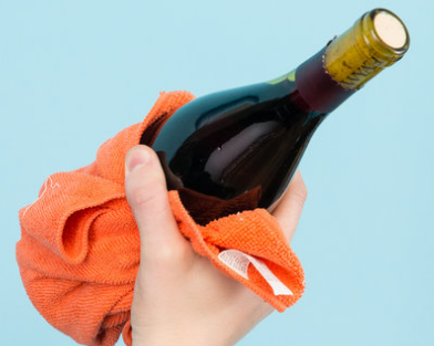 Use towel to Open a Wine Bottle without a Corkscrew